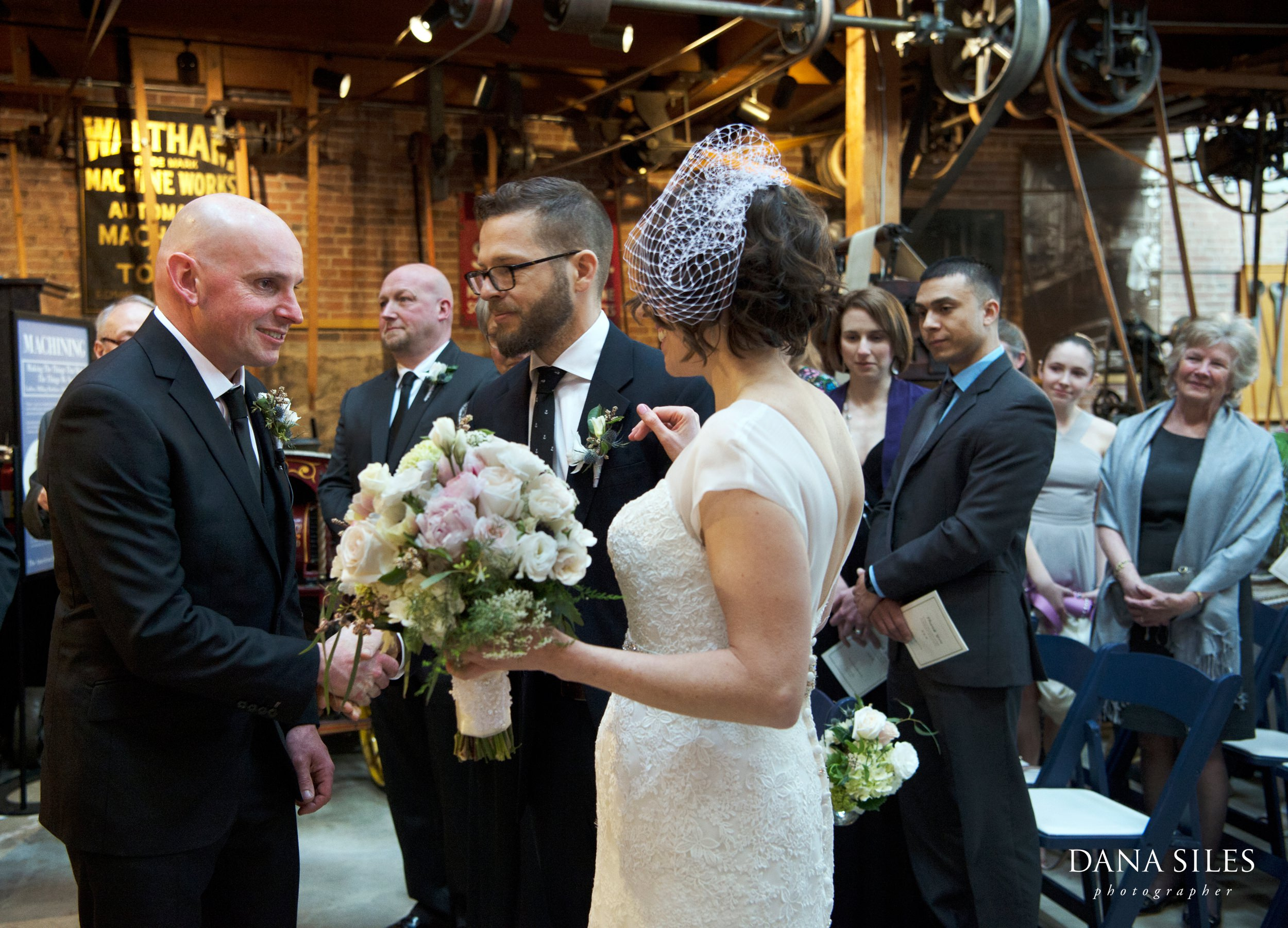 Charles-River-Museum-wedding-ceremony-giving-away