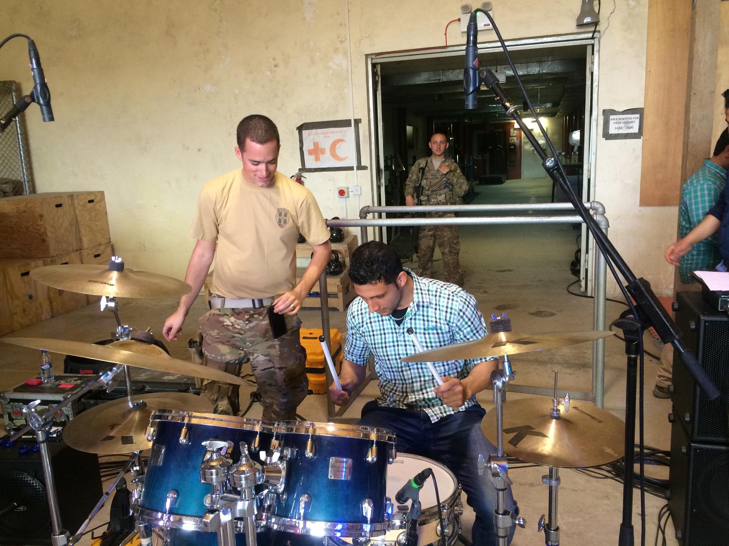 Having some fun teaching a few beats to a Afghan translator!