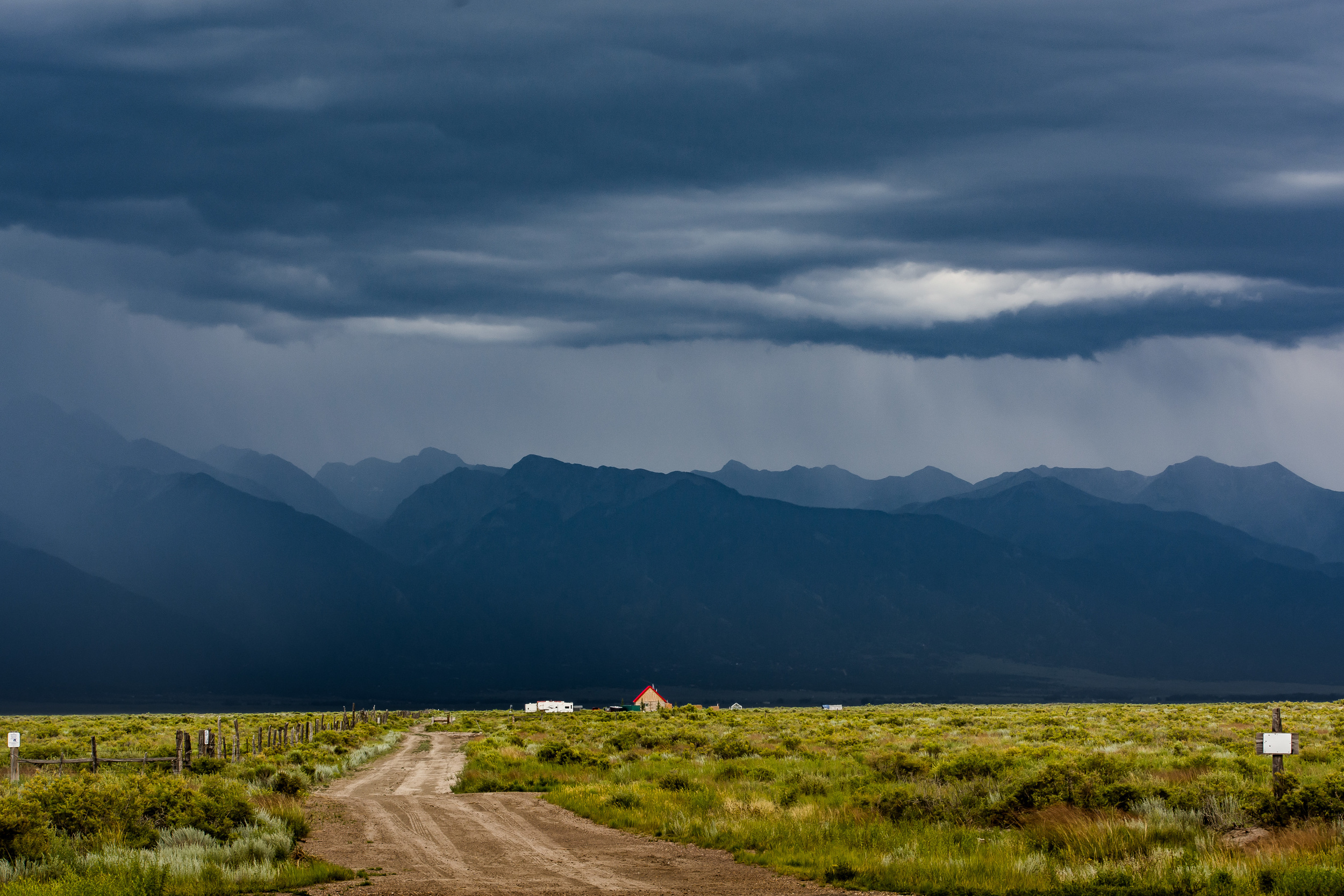 We were flanked by storms as we drove between two ranges in Southern Colorado heading to Santa Fe. We pulled off west of the Sand Dunes National Park to shoot this little scene. Amazing light.