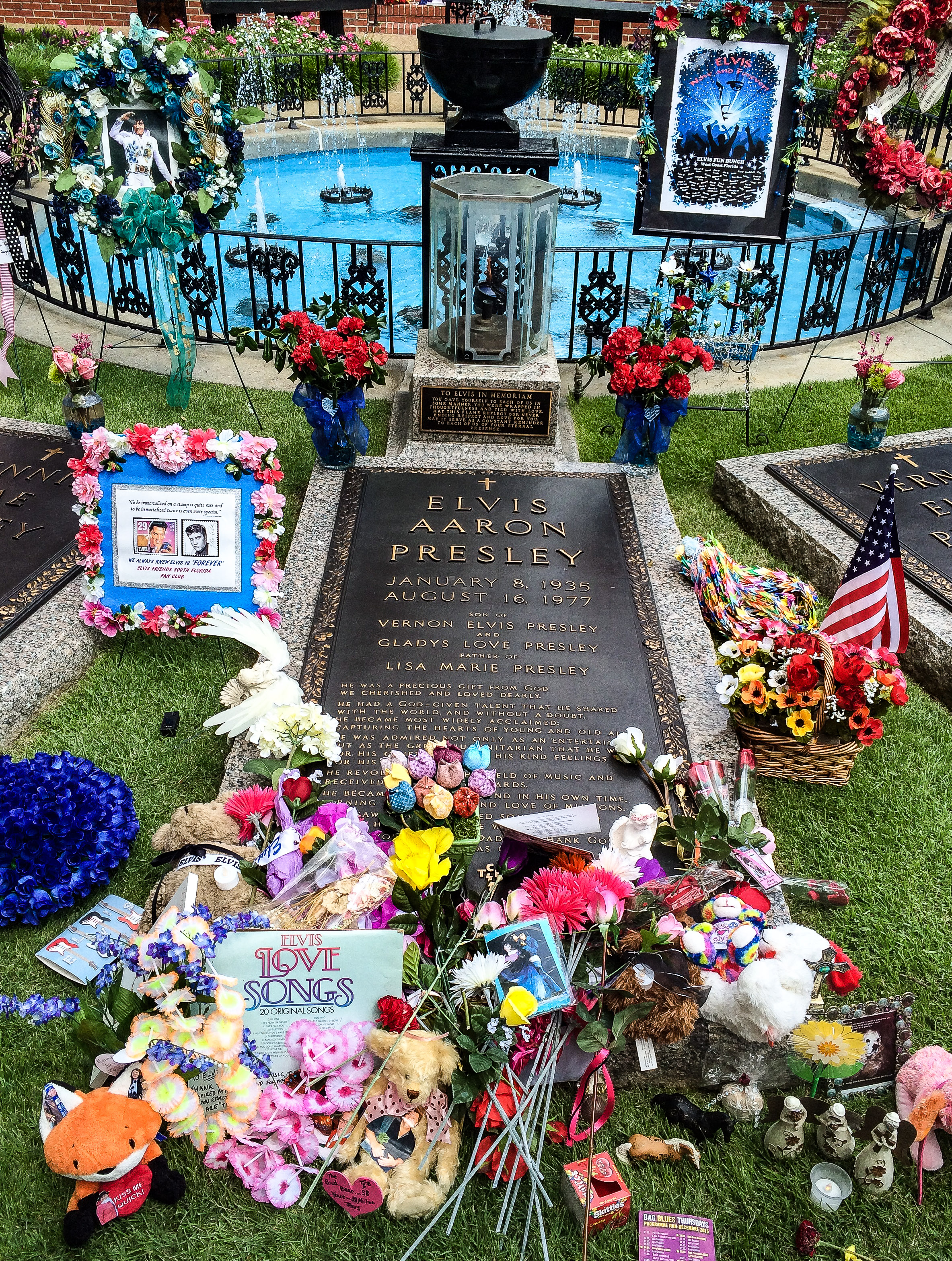 Elvis's grave. It's Elvis week, commemorating the anniversary of his death, so tons of fans send or leave things everywhere.