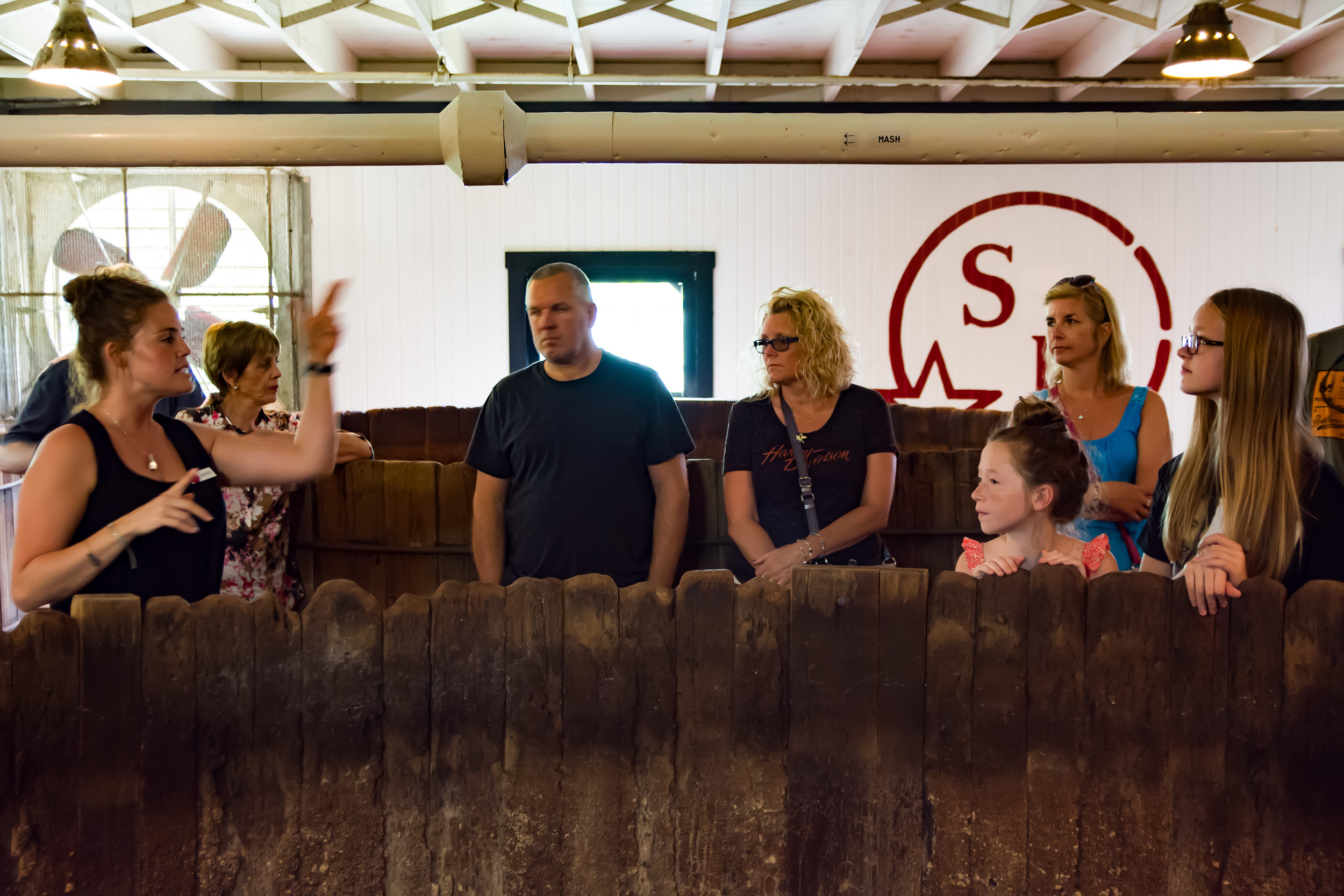 The girls learning about distilling by the 100+ year-old vats. I will be checking their room for stills...