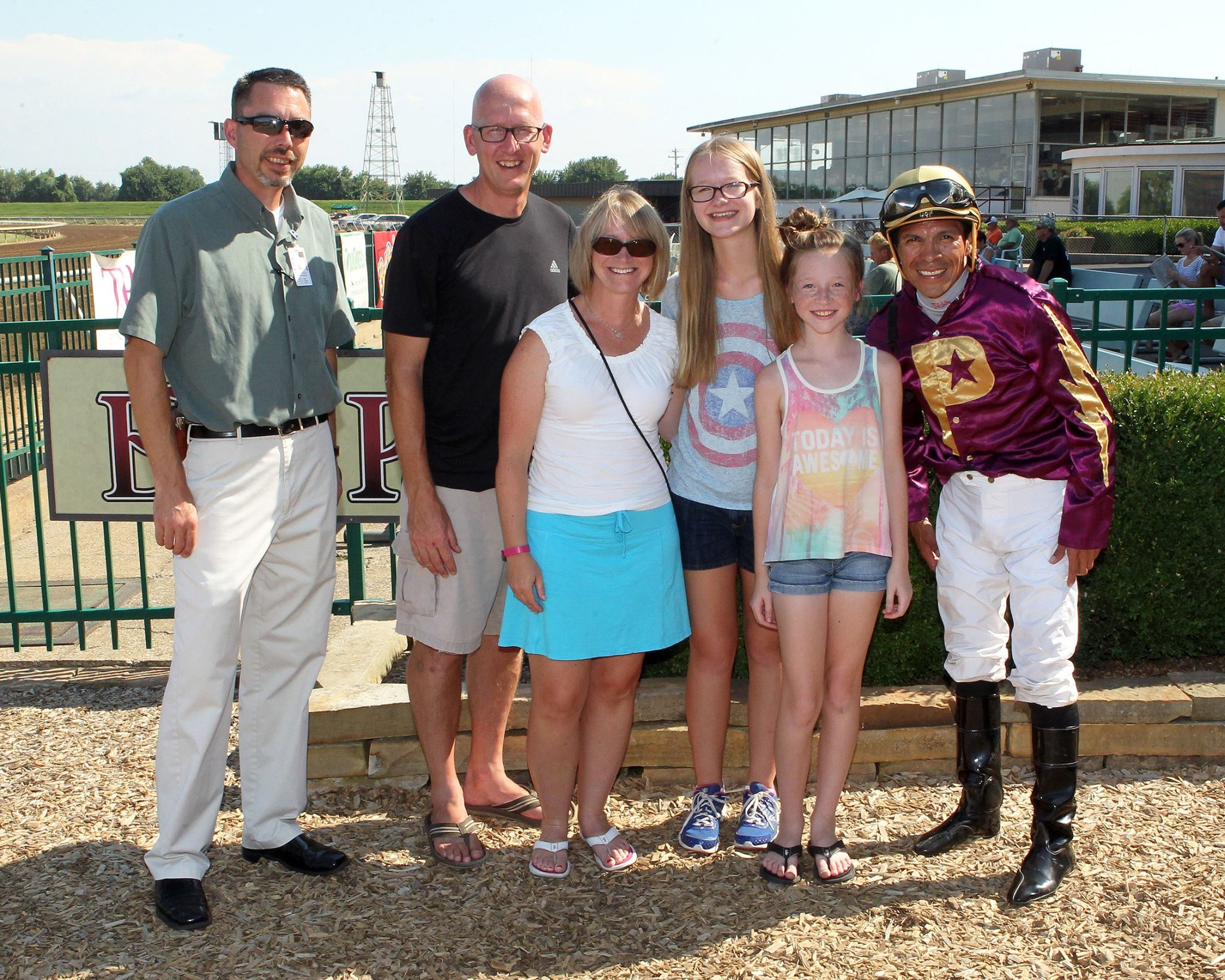 Photo courtesy Kurtis Coady of Coady Photography. Us, with our host Mike and winning jockey Jesus Castanon. He's a big deal, won the Preakness in 2011 and has won over 2,000 races!
