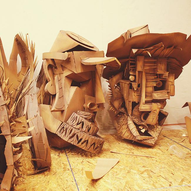 Cardboard puppet heads in progress.
