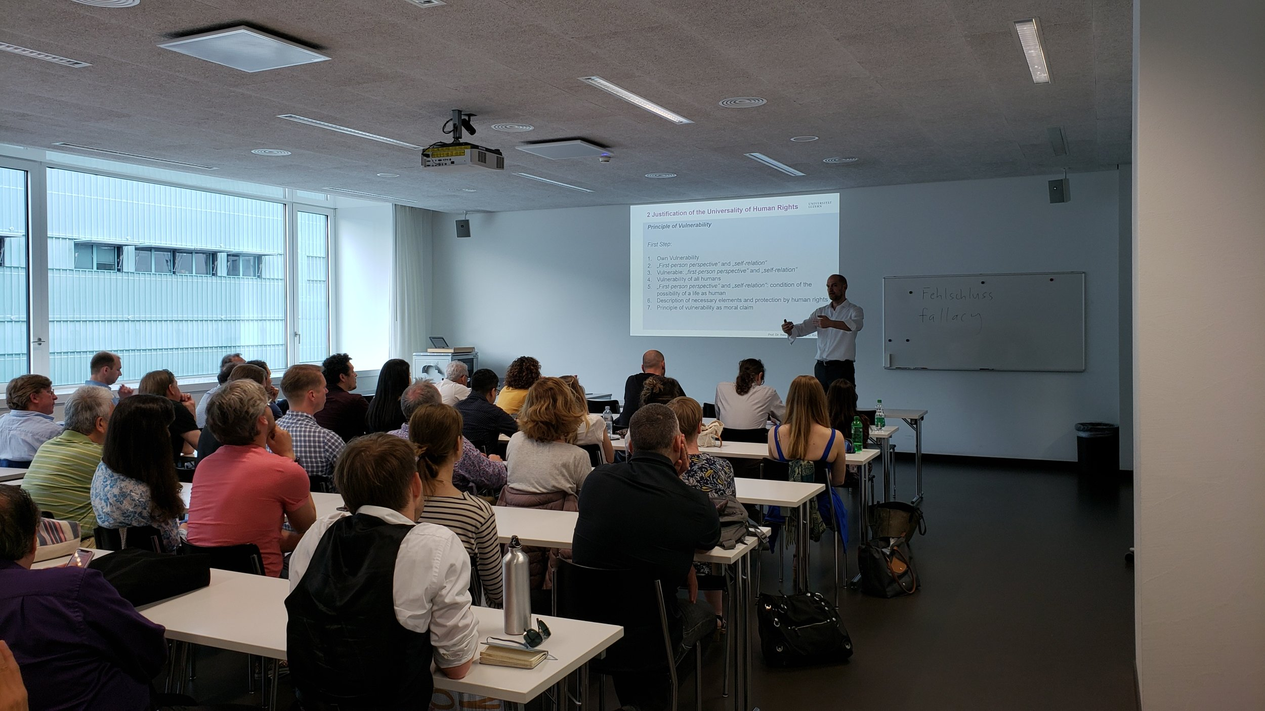 Lecture by Professor Peter Kirchschläger at the University of Lucerne, Switzerland, to the Human Rights Orchestra between rehearsals