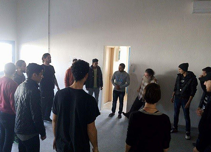 men standing in circle.jpg