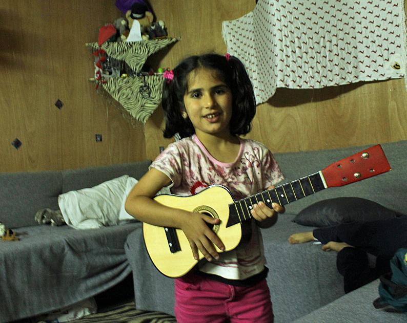 6. girl guitar REV.jpg