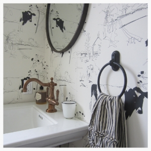 A much-needed powder room was carefully carved from extra space in the laundry room of a Wine Country get-away. Includes a wink to farm land whimsy with cow wallpaper imported from the UK.