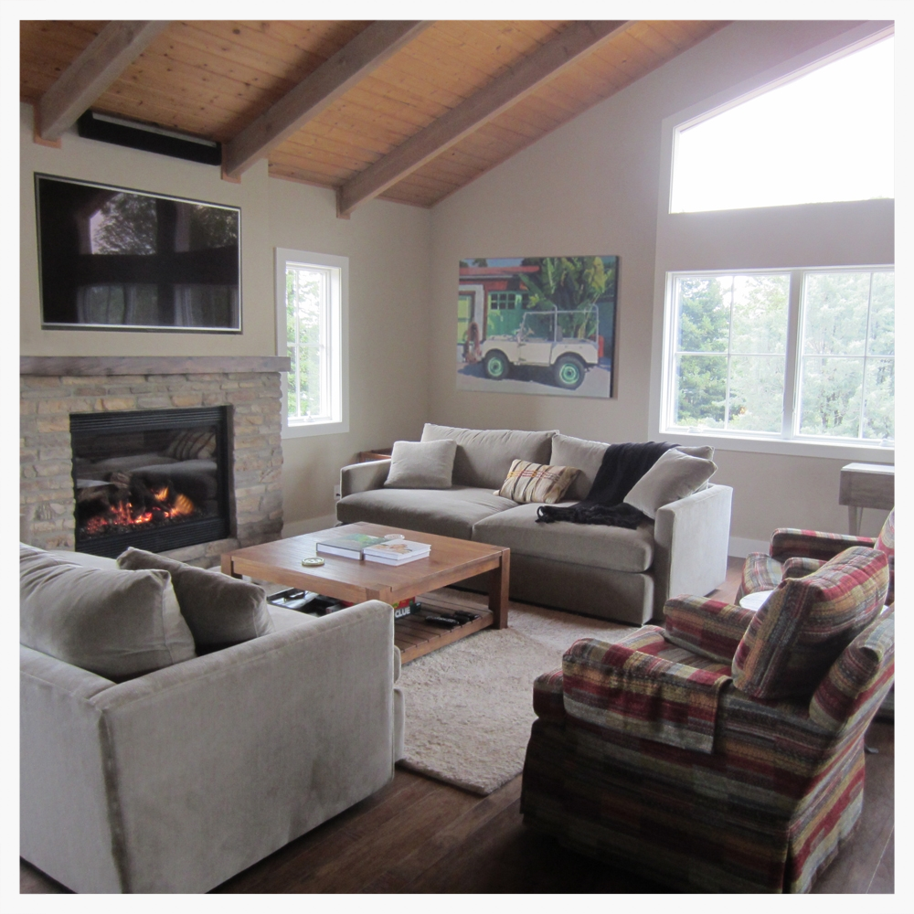 Updated great room from a 1970's den. Natural gas fireplace replaced a dusty lava-rock stove, walls were opened with large windows, and state-of-the-art audio/video includes a built-in TV that lowers.