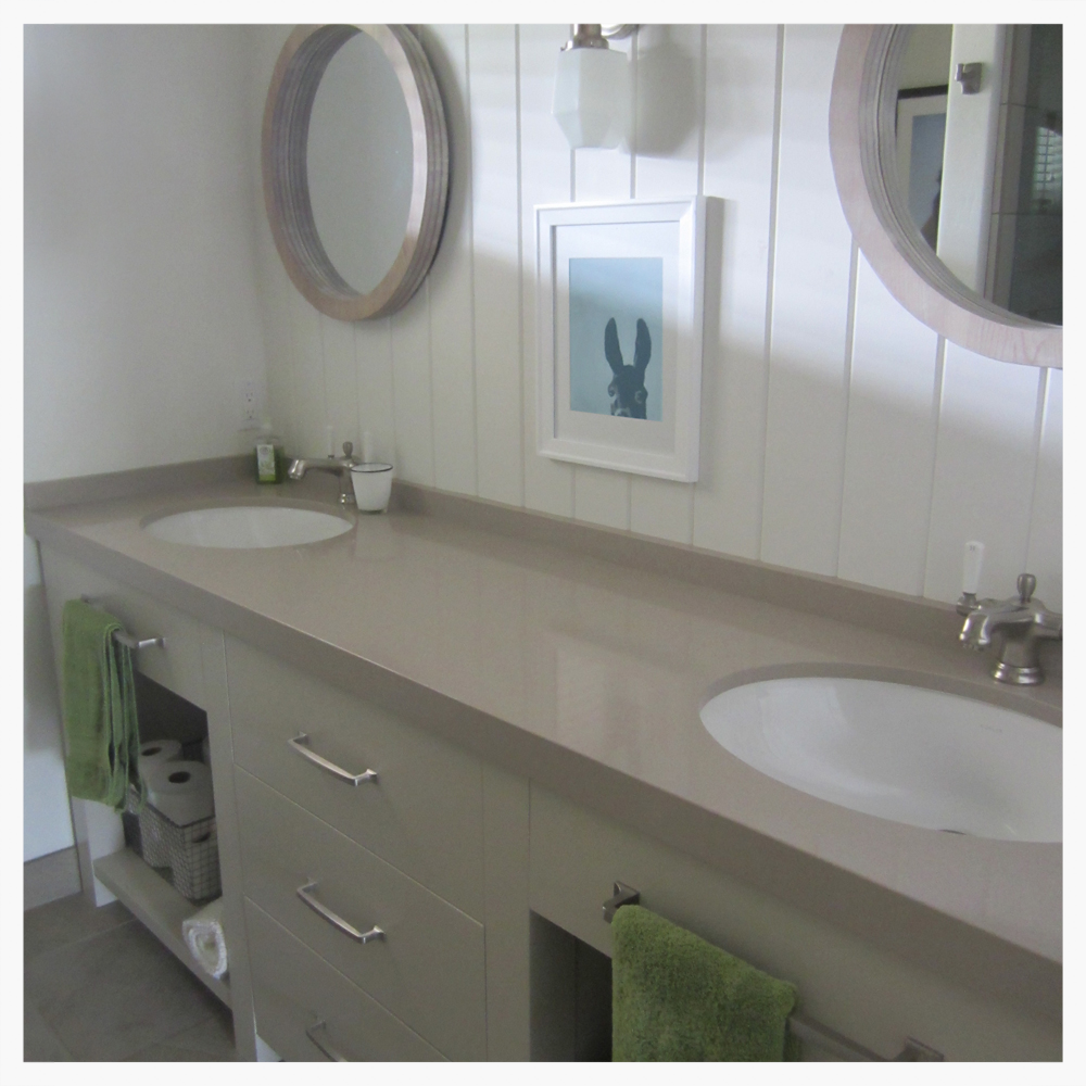 """A dark guest bathroom was refreshed in bright white plank board walls, and a custom vanity. 2"""" thick reclaimed quartz countertop adds a substantial quality. Open vanity cabinets for a casual user-friendly charm."""