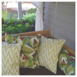 A covered porch is the perfect placefor a nap on hot days, or sleeping alfresco. The twin-sized pine swing bed was ordered on eBay and the pillow covers were custom made from a seamstress on etsy.