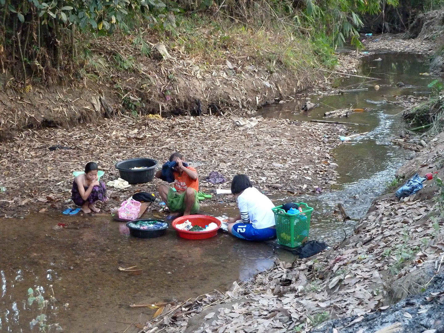 The locals doing laundry at the water source (Fung Na community)
