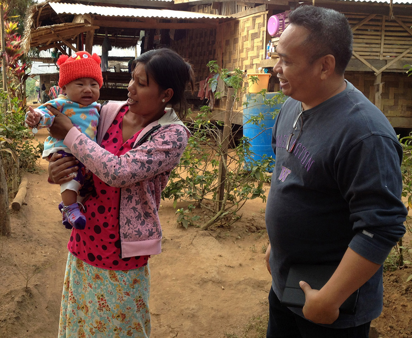 Greeting the locals in Ban Mai community