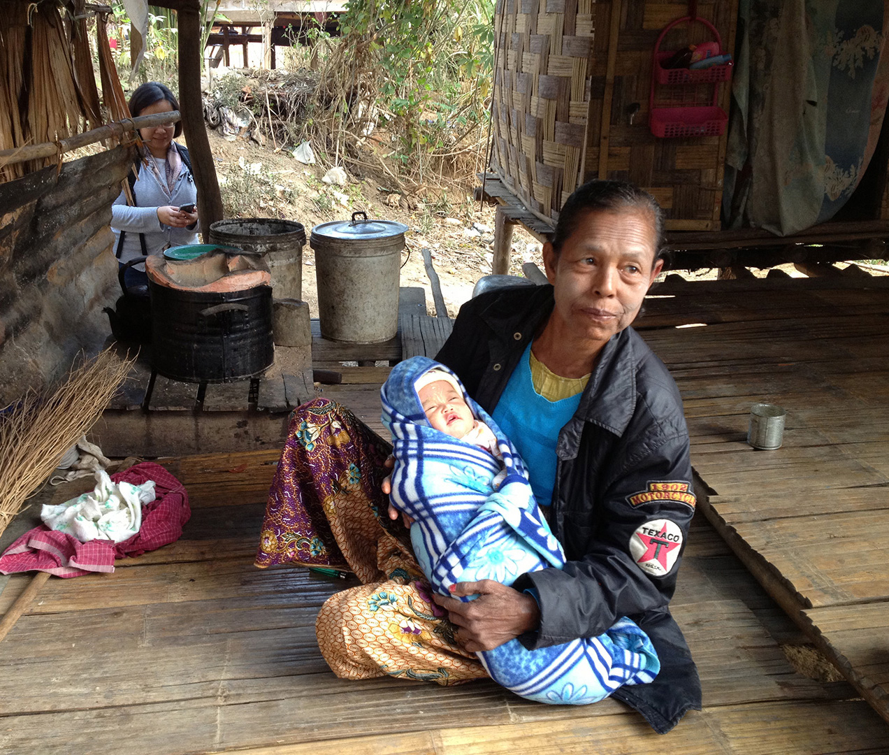 A days-old newborn being cared for (Ban Mai community)
