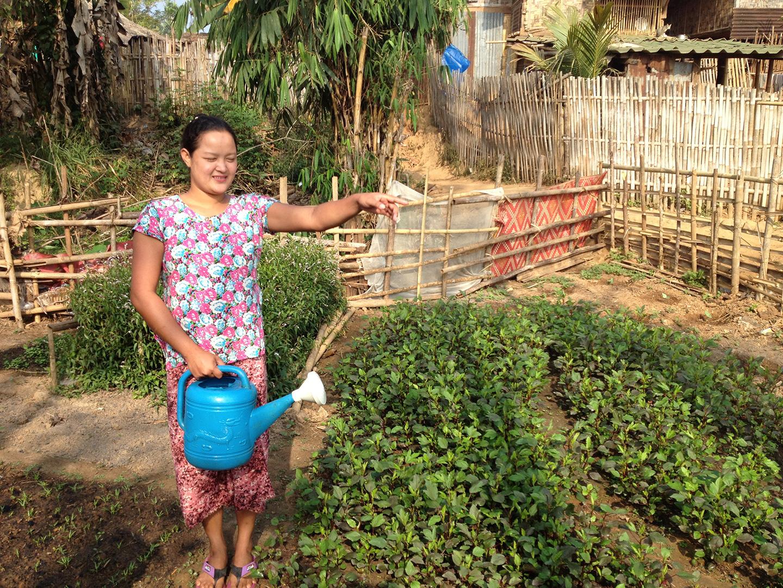 A local tending to her garden (Ban Mai community)