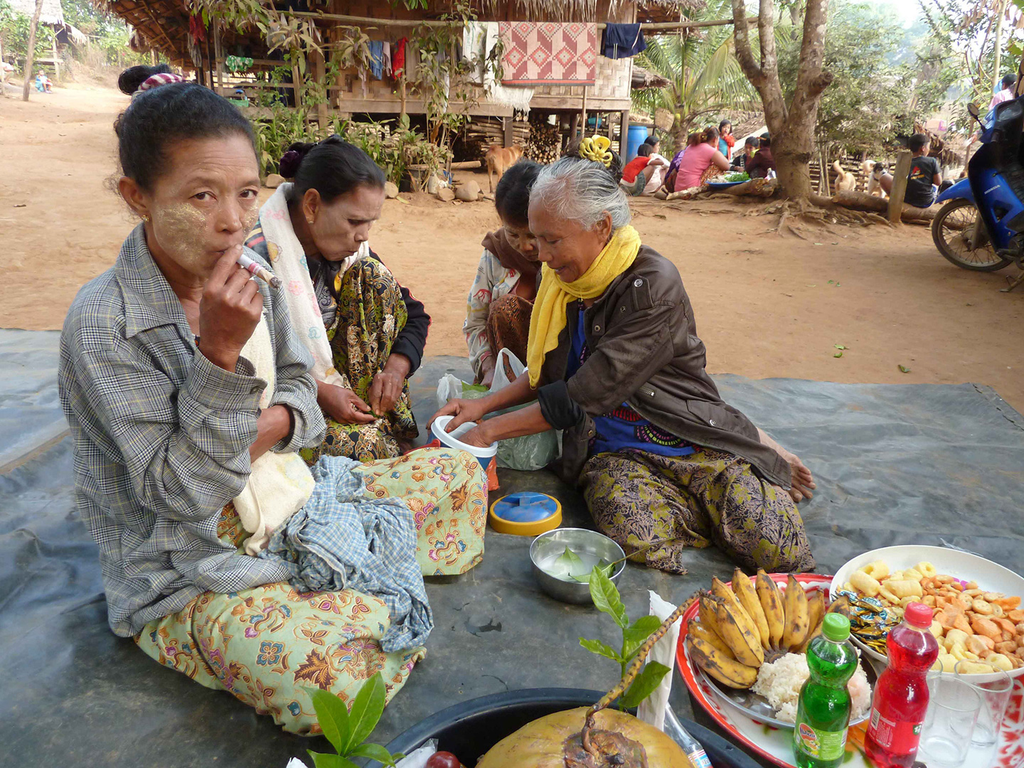 The locals smoking at a ceremony to bless a newborn (Ban Mai community)
