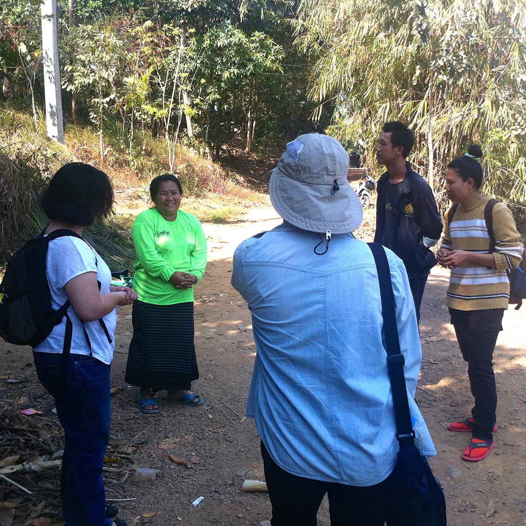 Talking to a health volunteer in Song Ka Lia community