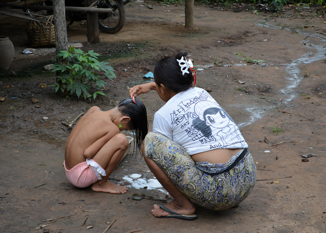 A mother washing her daughter's hair