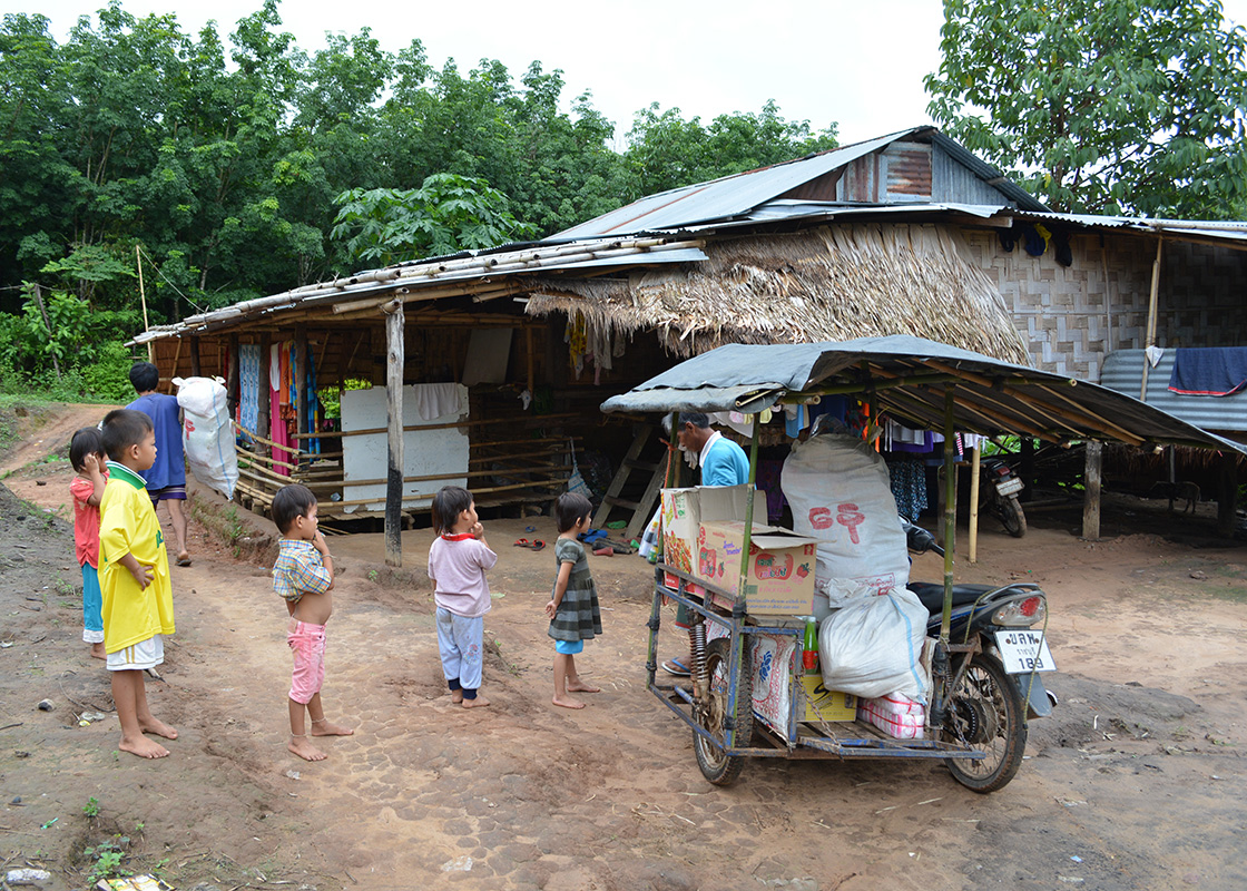 One household buys goods from the town and resells them to the other households.