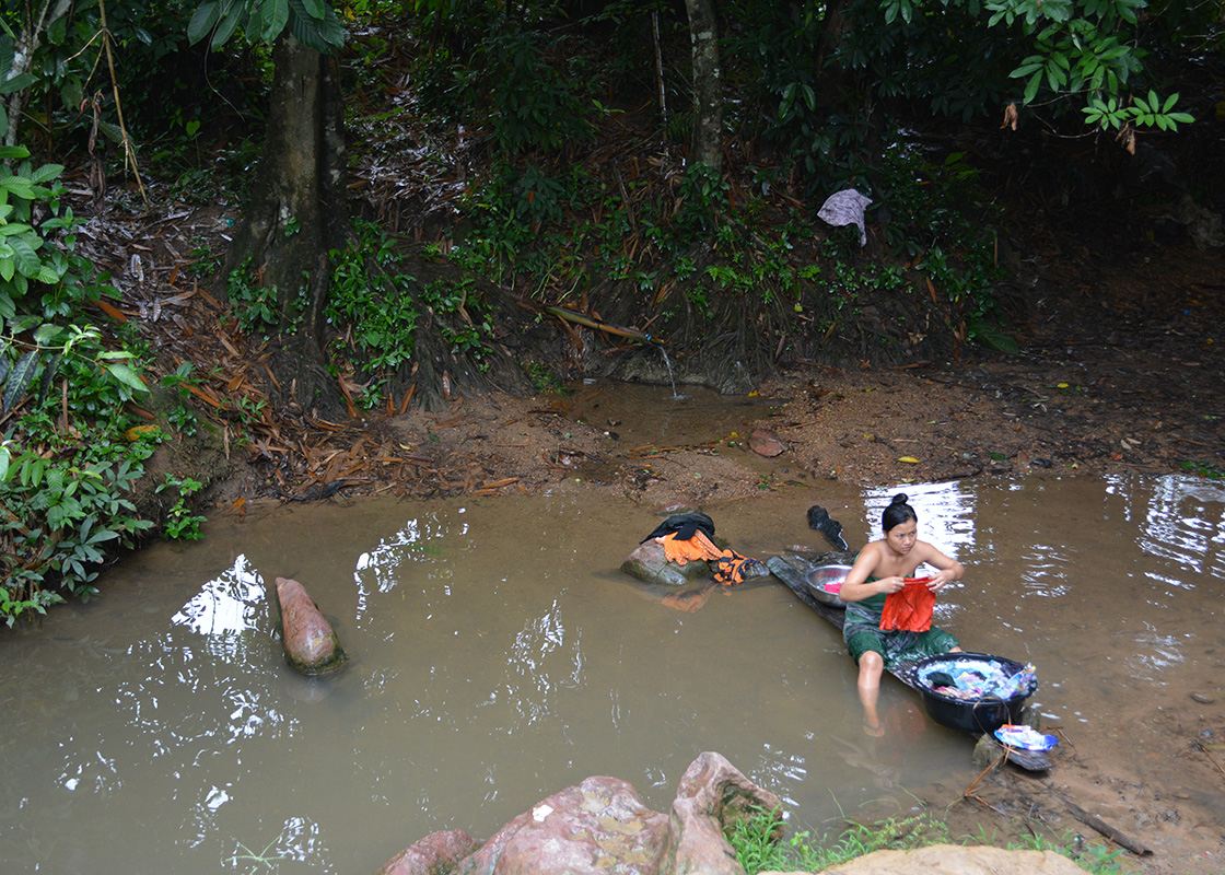 The small stream where the locals do laundry, bath, and collect water for household use