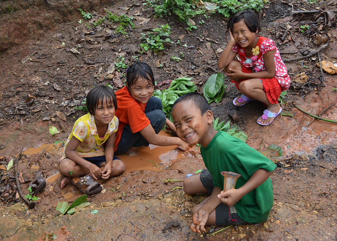 Children in Ban Mai playing after the rain