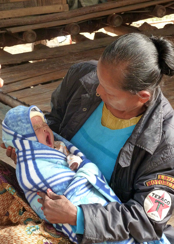 A newborn being cared for