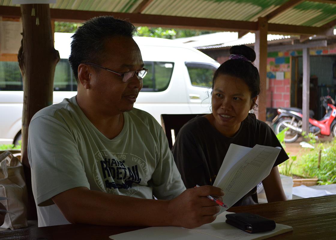 Asoke and Piyawan reviewing the questionnaires