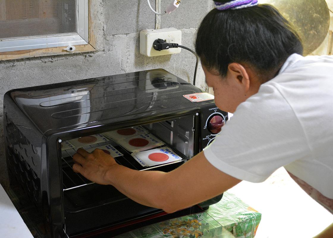 Piyawan checking on the samples