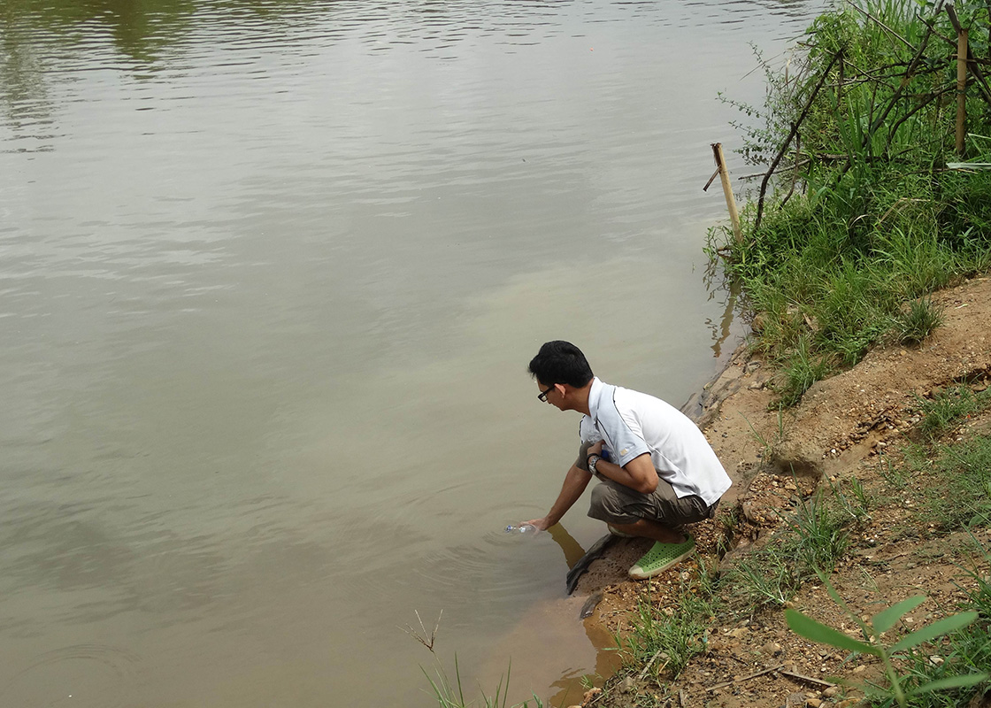 Collecting water samples from Ban Mai