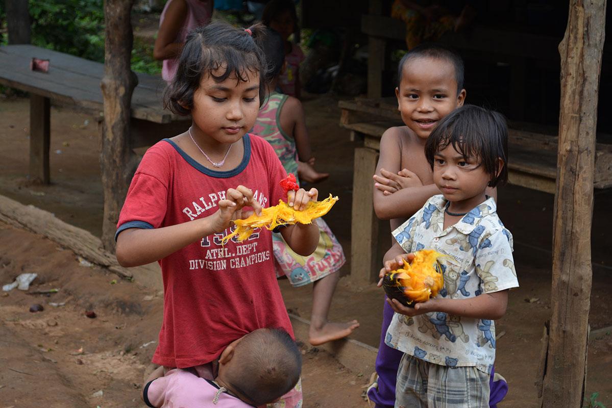 Children having a snack in Ban Mai.