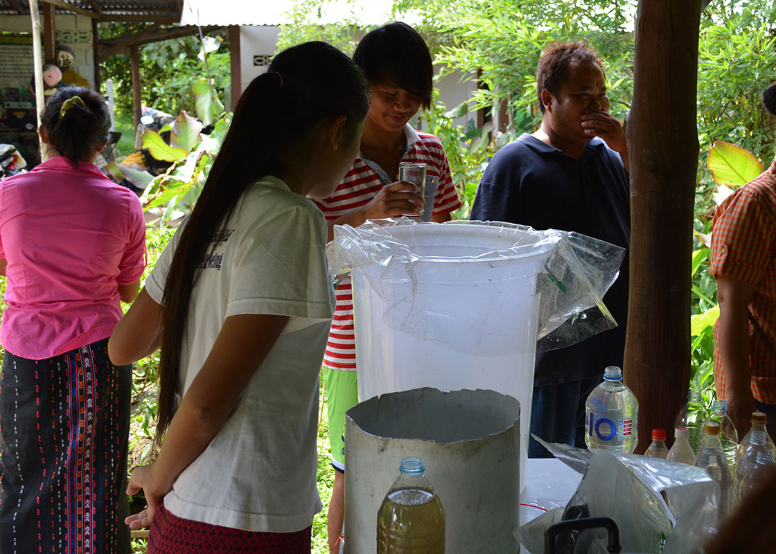 Participants checking out a simple water filter.