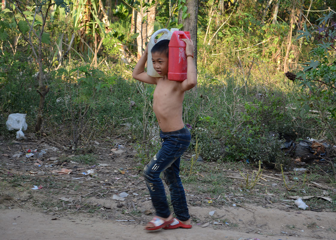 A boy from another family carried water back to his house.