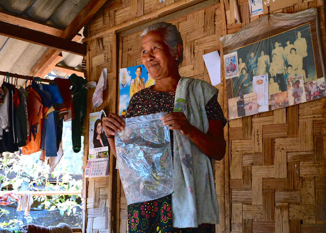 This woman showed how she patched the corner of a SODIS X bag that was punctured, so that she could continue to use it.