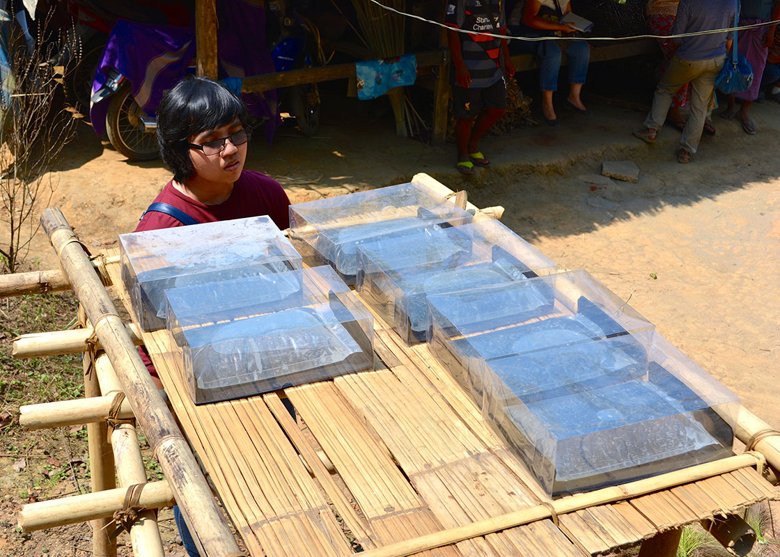 Phitchaya inspected the SODIS X sets that were being used at another household.