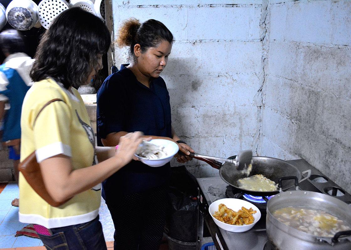 Supamas and Saisamorn helped make dinner.
