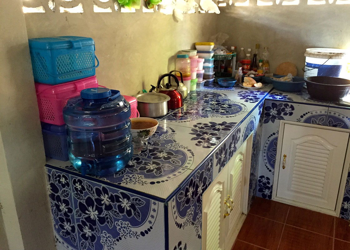 This household in Mong Sa Tur keeps their container of disinfected water on the kitchen counter.