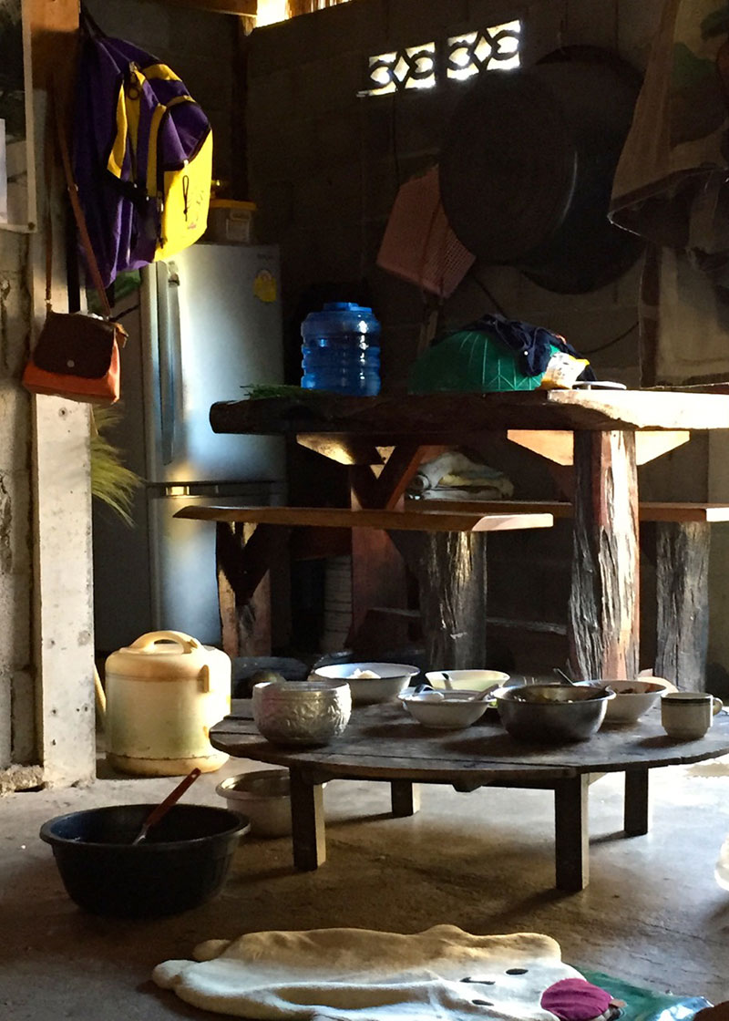 This household in Mong Sa Tur keeps the disinfected water in the kitchen both at room temperature and refrigerated.