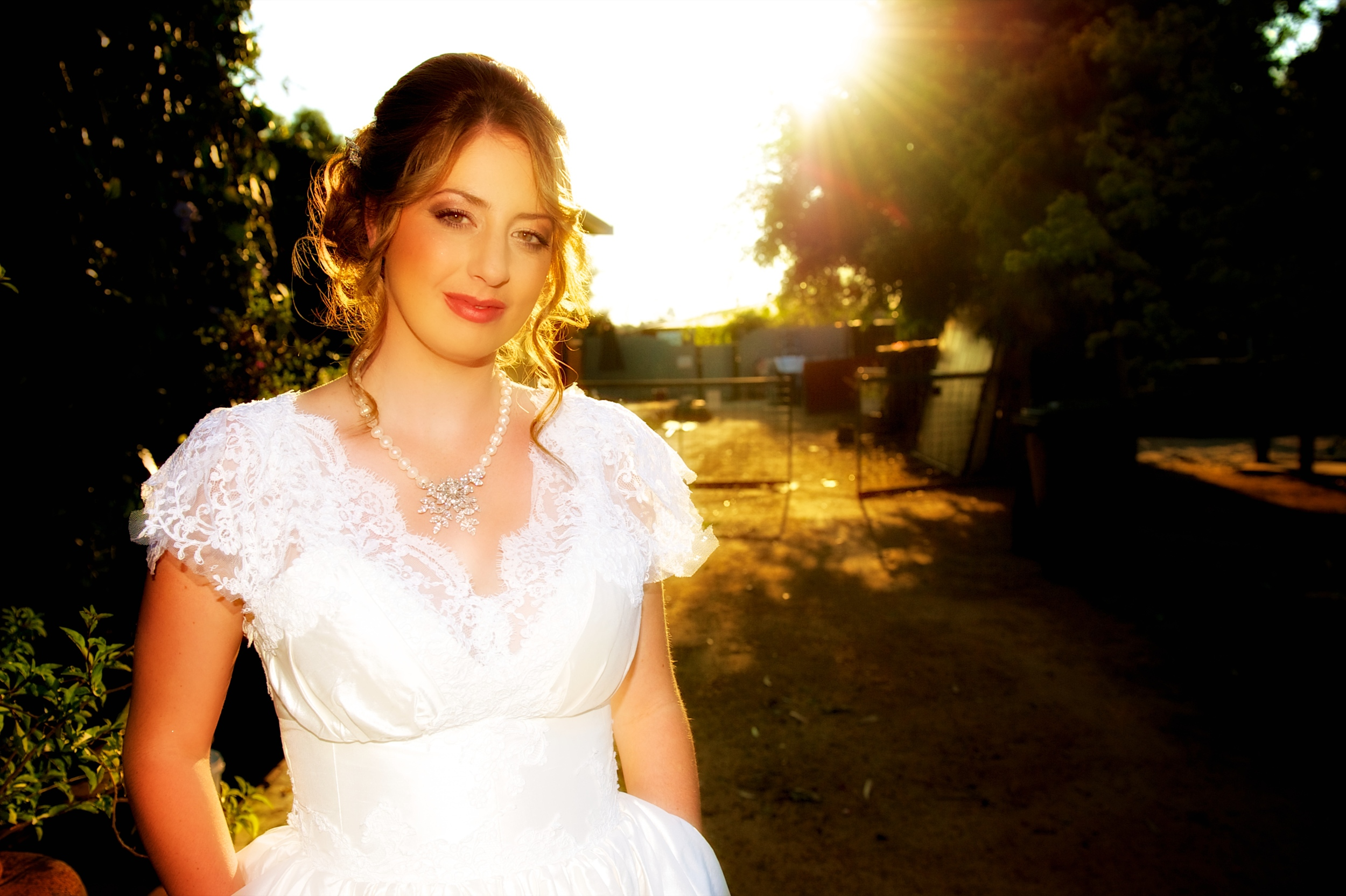 A beautiful image of a bride in the sunset at Chapel Farm, Swan Valley