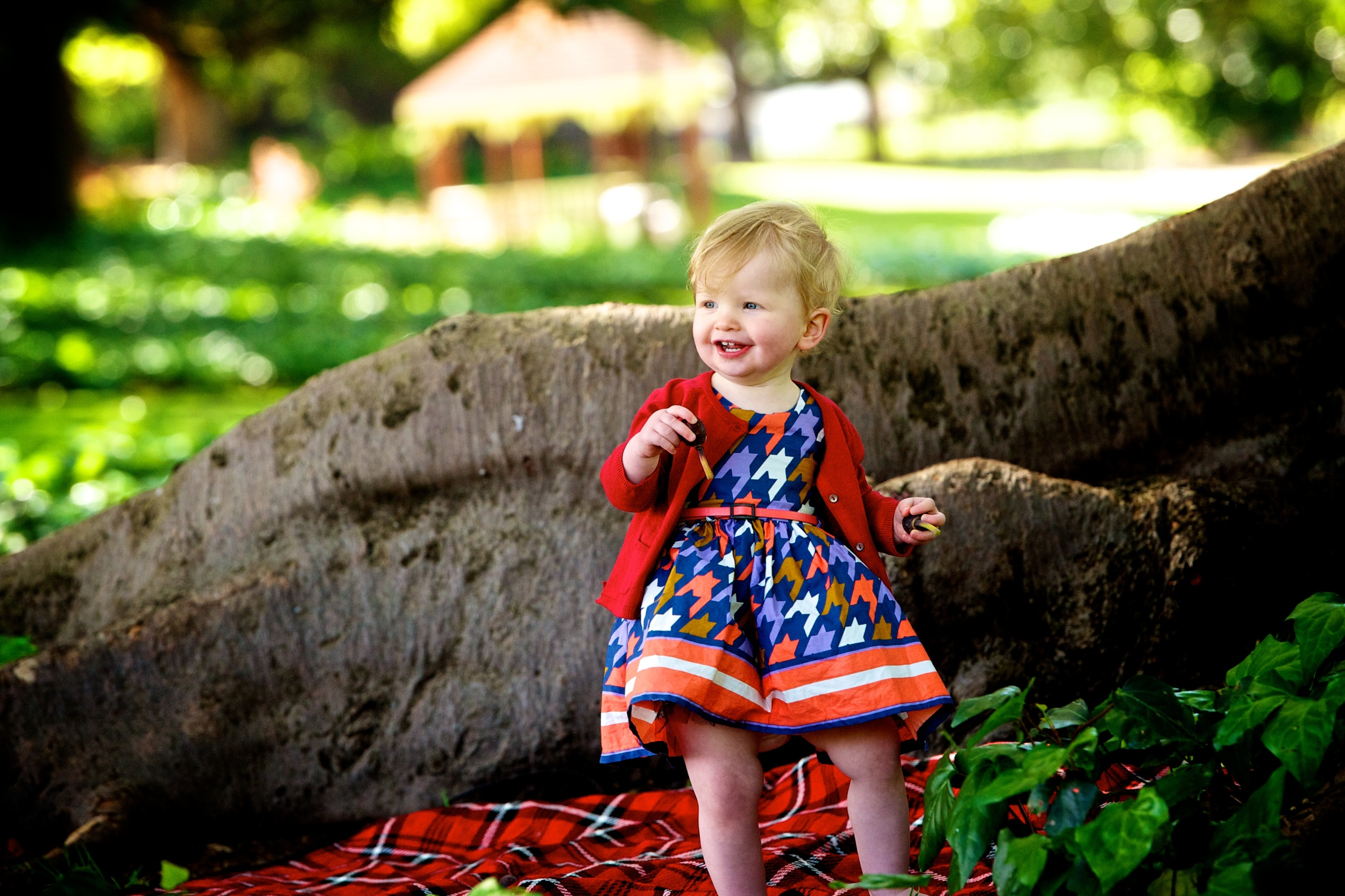 A little princess smiles and laughs during a family photo session in Hyde Park