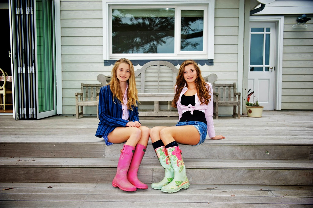 This photograph shows sisters sitting showing off there new boots, Jersey Channel Islands