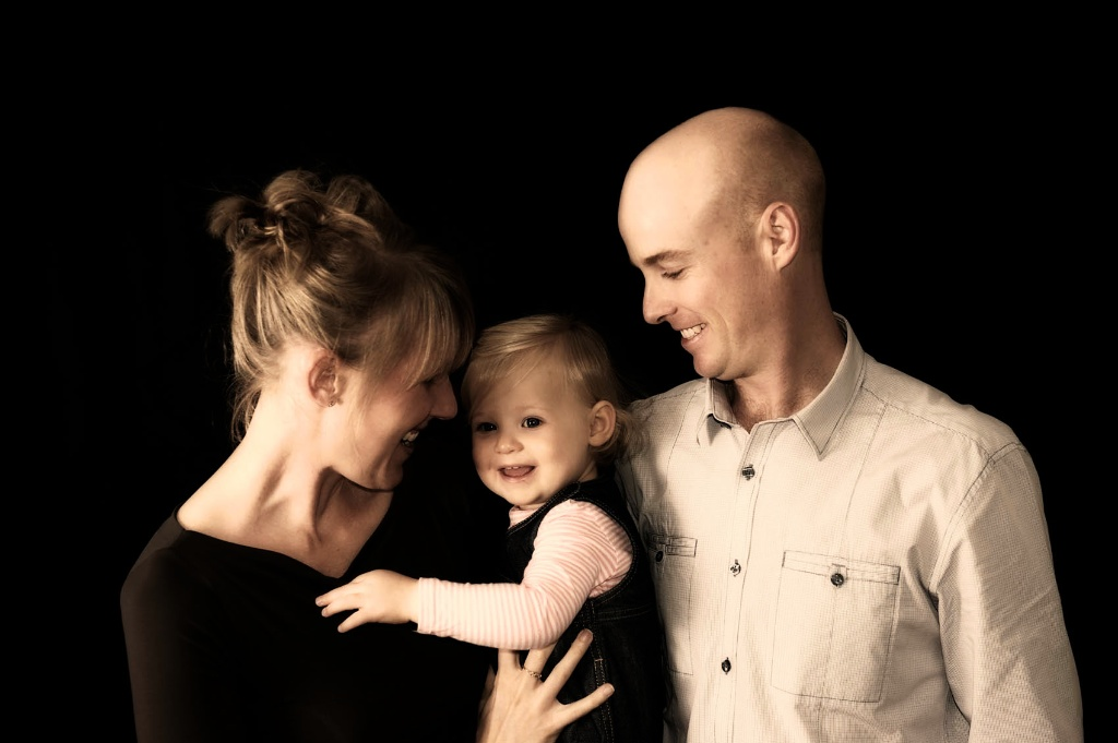 A family shares a tender moment during their family photography. Perth Western Australia