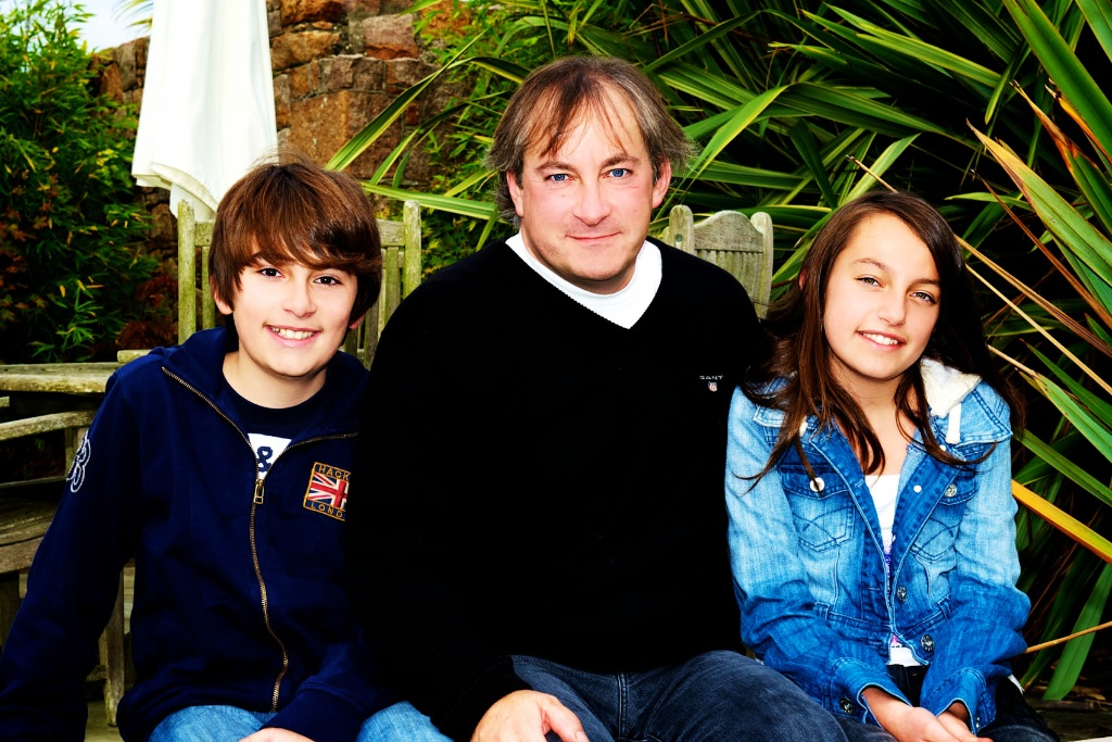 Family relaxed and casual during their photos on Jersey Channel Islands. Image taken by Warnock Imagery