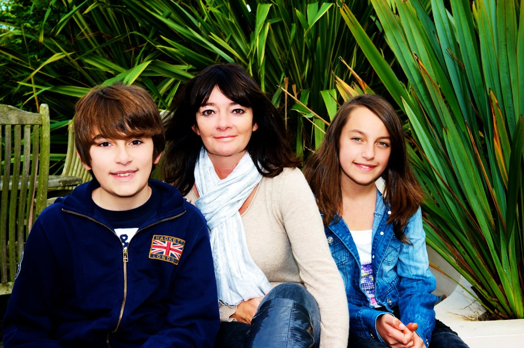 A mum, son & daughter smile for the camera in this family photo.  Image taken by Warnock Imagery