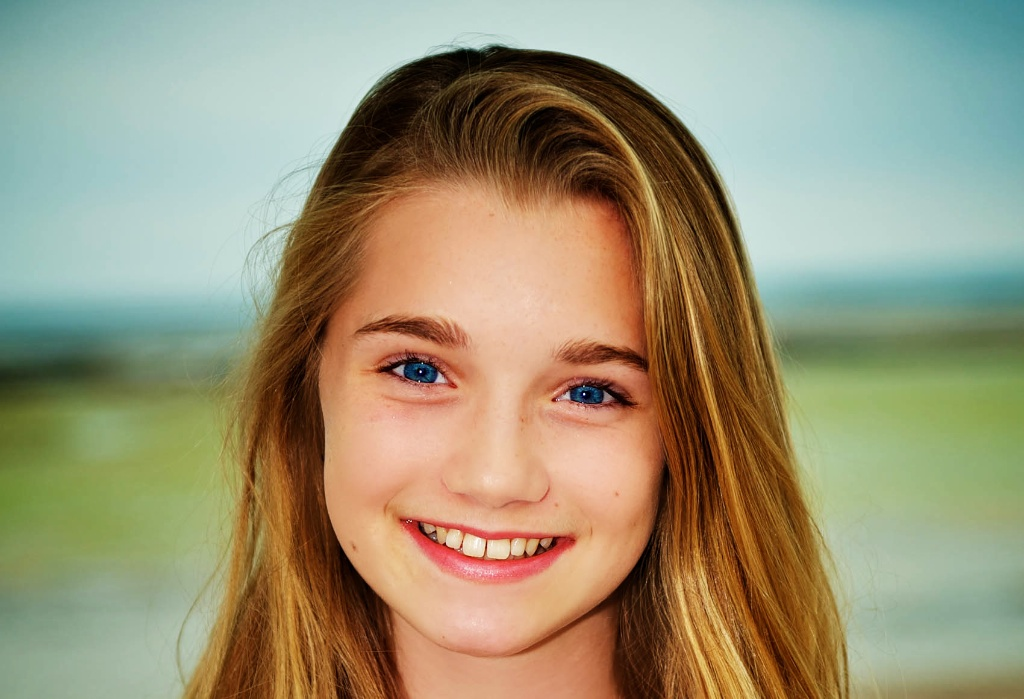 A beautiful image of a young girl during her family photography session by Warnock Imagery. Perth