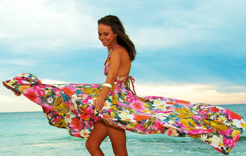 A very colourful dress helps this model photography stand out in front a grey sky. Image Taken by Warnock Imagery