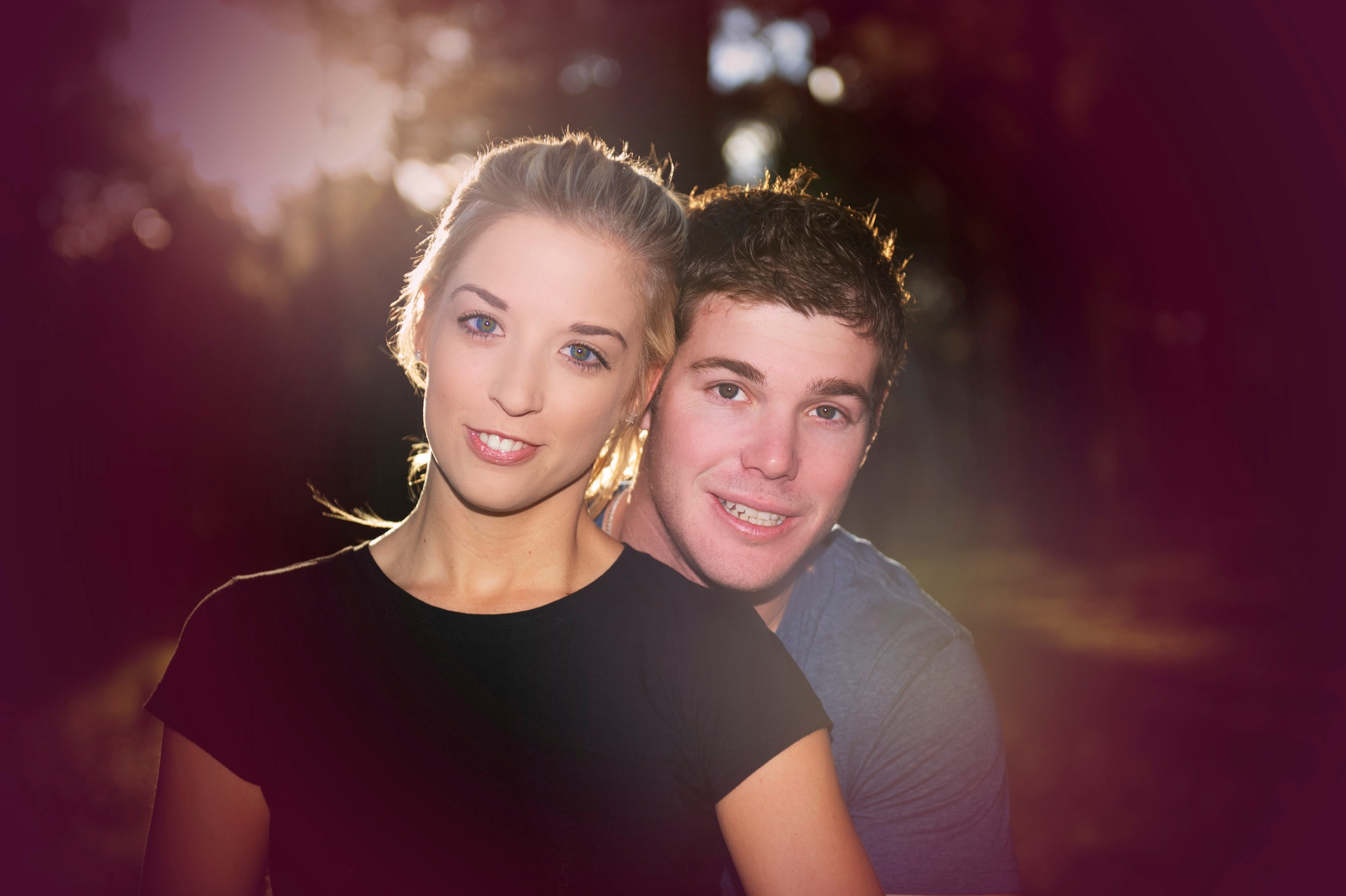 This image shows a very happy couple that will soon be husband and wife