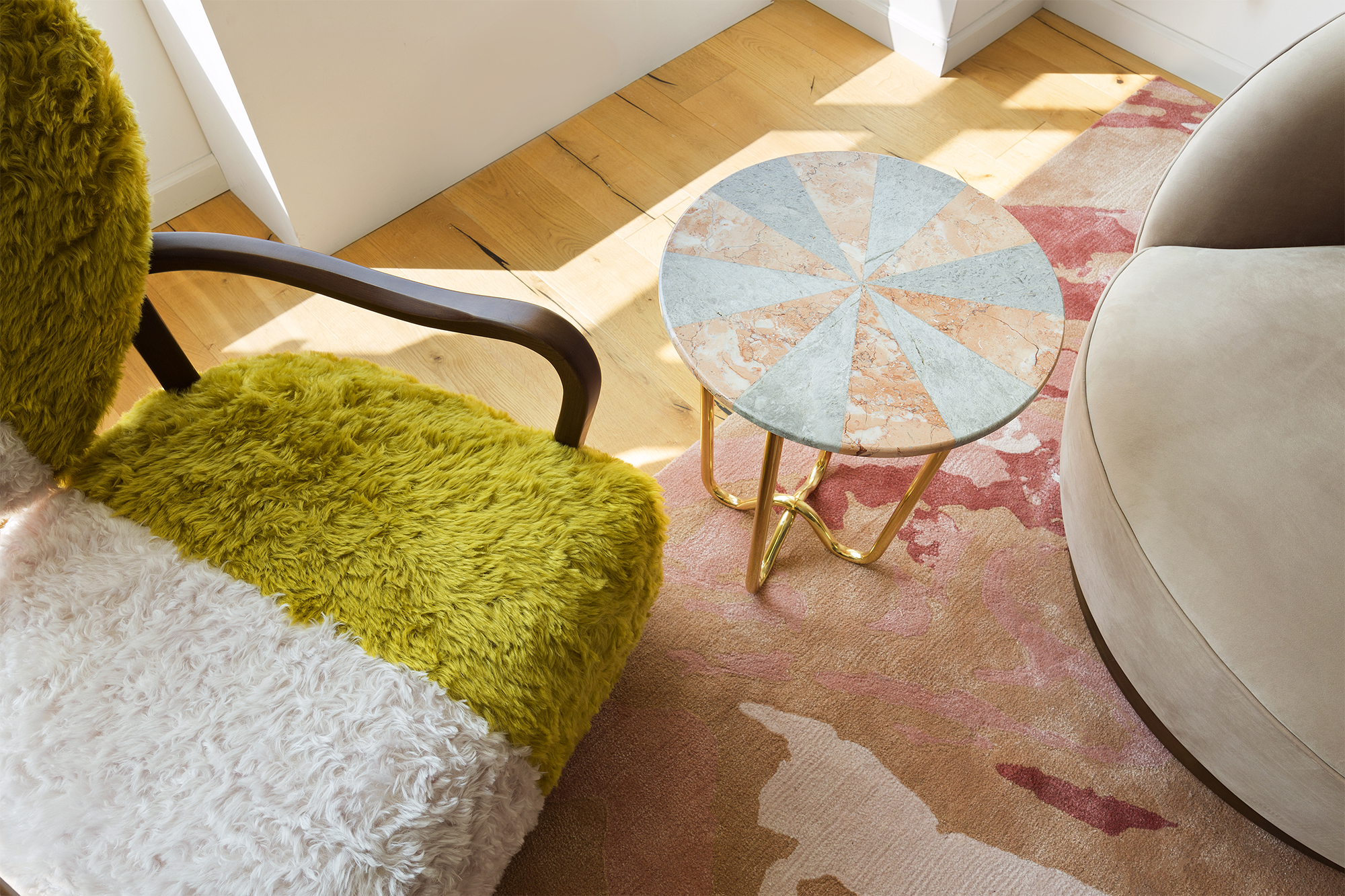 Uni Chair, Jasmine Pizza Table and Custom Designed sofa and rug