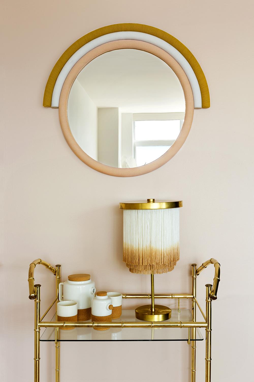 Iris Mirror, vintage bar cart and fringe table lamp.