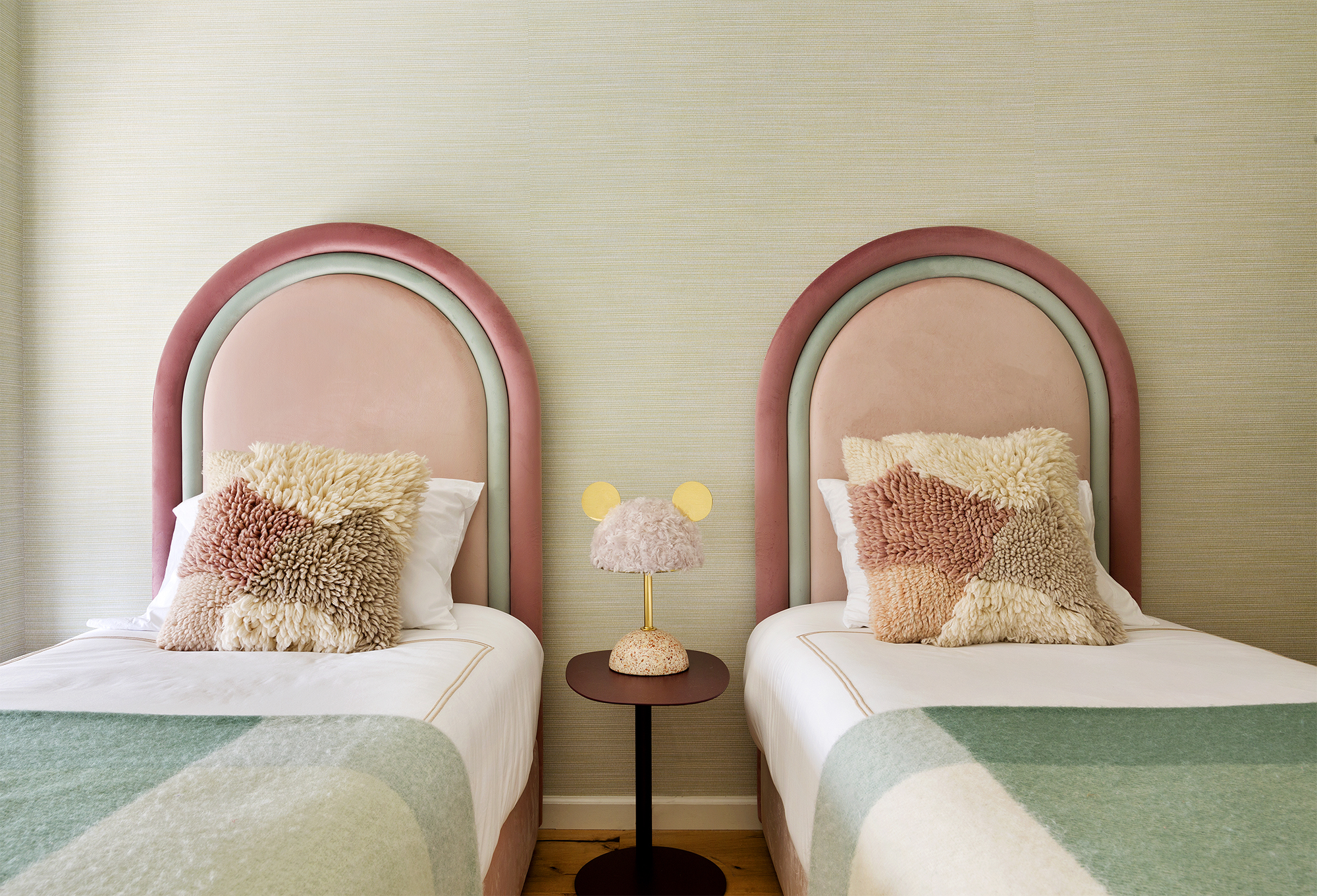 Custom designed velvet beds, minos lamp.