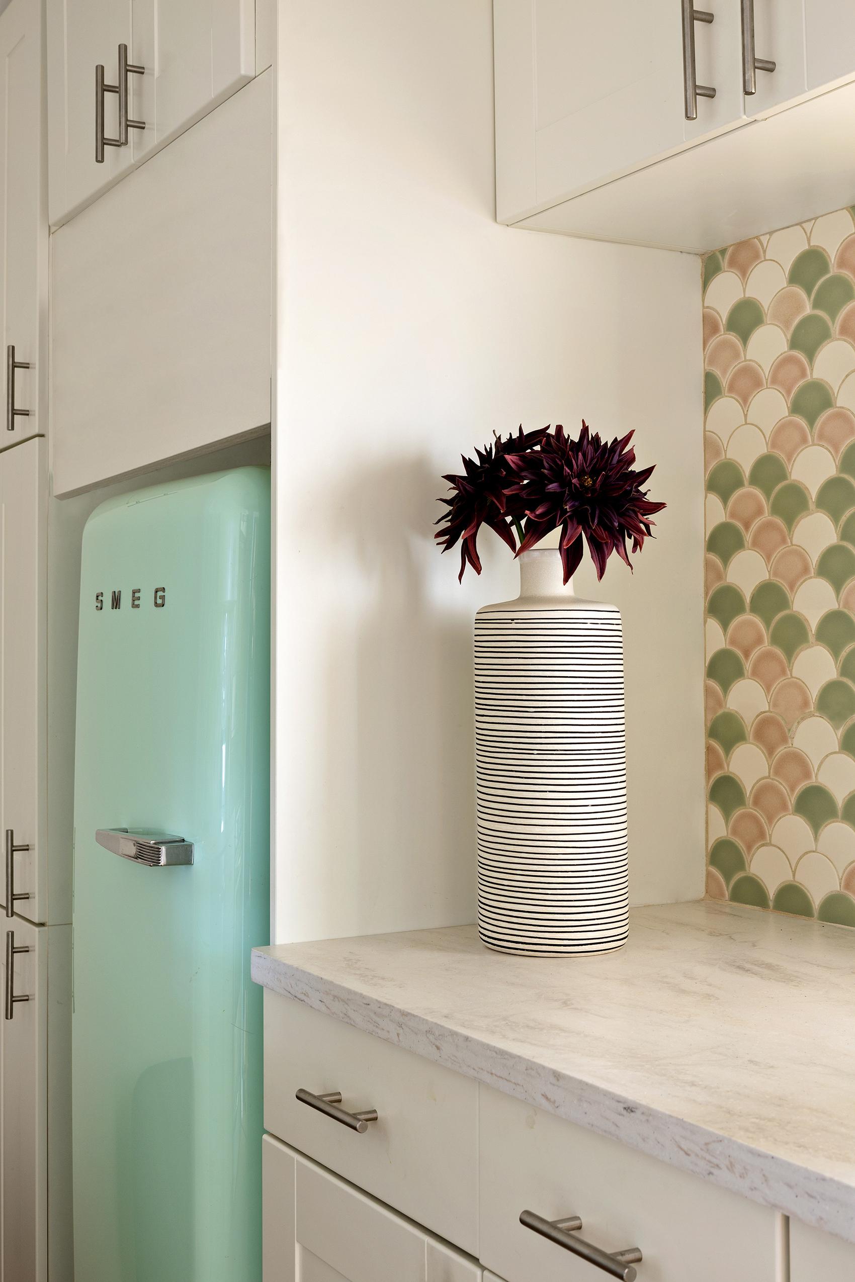 Smeg refrigerator and custom tiles for kitchen.