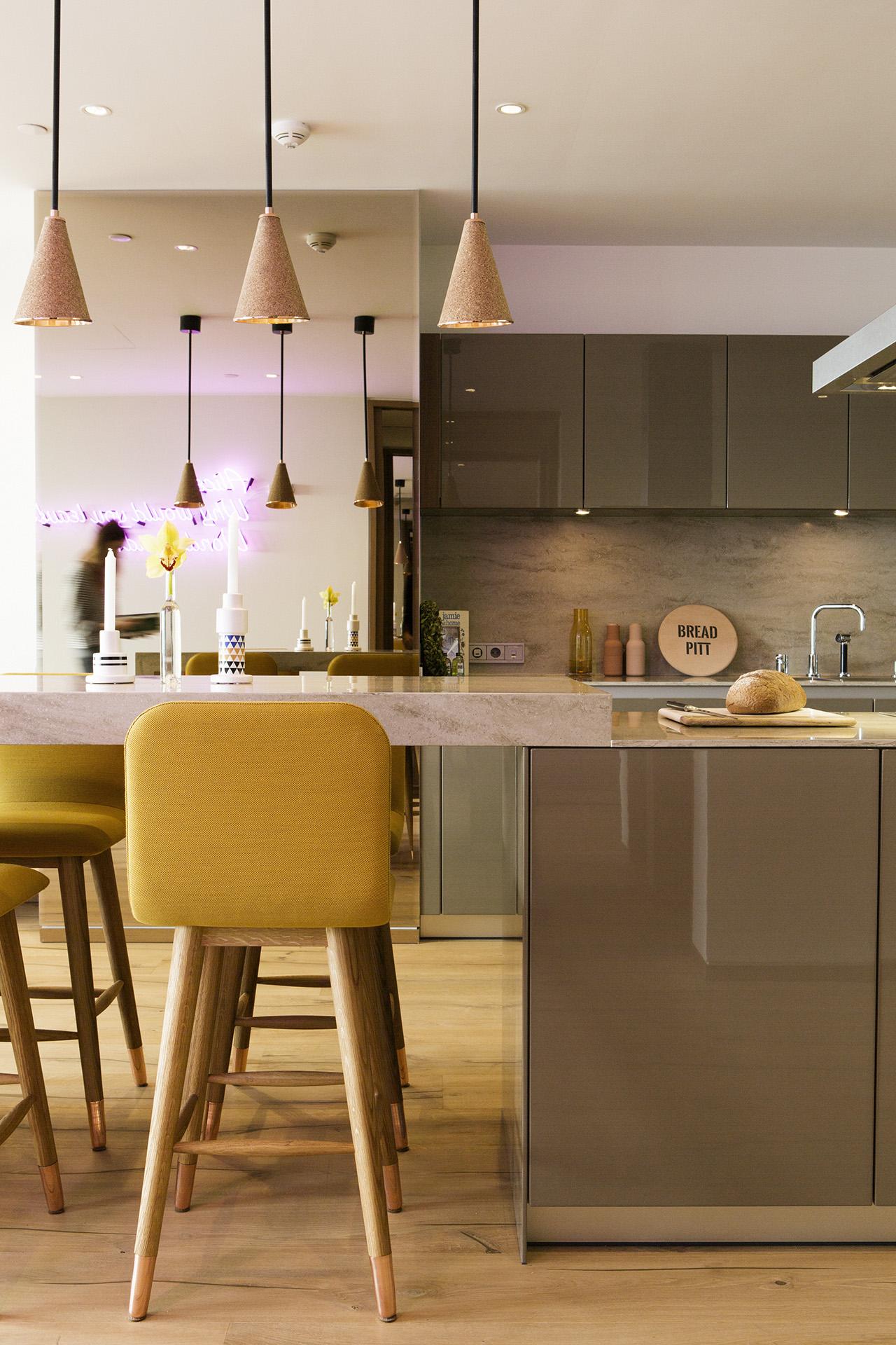 Mistral bar stools, lanterna ceiling lamps and custom designed kitchen.